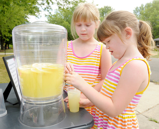 Sisters Morgan and Amber Ward set up a lemonade stand on Saturday to raise money for their grandmother Melinda Wright who is battling breast cancer.