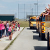 The entire faculty and staff of Frankton Elementary School wave goodbye to the departing students on buses at the end of the last day of the school year for the Frankton-Lapel school system.