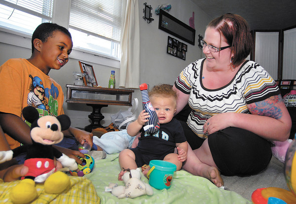 Elizabeth Finley, a college grad with a lot of debt, at home with her sons Zayden, 7, and Azir, 7 months.