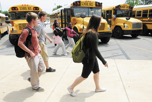 Students leave at the end of the day on the last day of school at Anderson High School on Thursday. ACS students are scheduled to return to class on Monday August 20th.