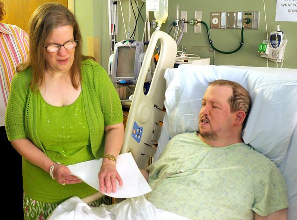 Sarah Blake reads her vows as she marries Kevin LaRose at St. John's Hospital on Saturday. Sarah and Kevin decided not to let an unexpected illness postpone their nuptials.
