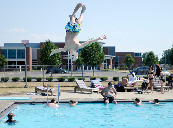 Mercklin Dewitt, 12, of Anderson flips off the diving board while swimming at the Southside Sports Complex on Wednesday. Wednesday was the Summer Solstice, recognized as the first day of Summer and the longest day of the year.