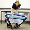JoAnne McDaniel demonstrates setting up a portable playpen and basinet during a Safe Sleep Class at Community Hospital on Wednesday, June 13, 2012.