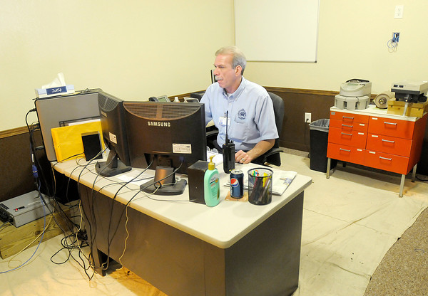 CATS dispatcher Jerry Almond works in the new conference room as the dispatchers office is being renovated. In an effort to save money and recycle the CATS offices are being remodeled using material salvaged from Edgewood Plaza which is scheduled for demolition.