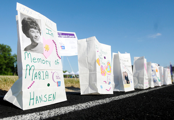 Luminaries line the track during the Relay for Life at Highland Junior High School on Friday.