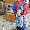 Jay Ricker dressed as Pops the clown poses for a photo with Jordan Greene, 7, at the Rickers located at 9th and Scatterfield on Thursday.