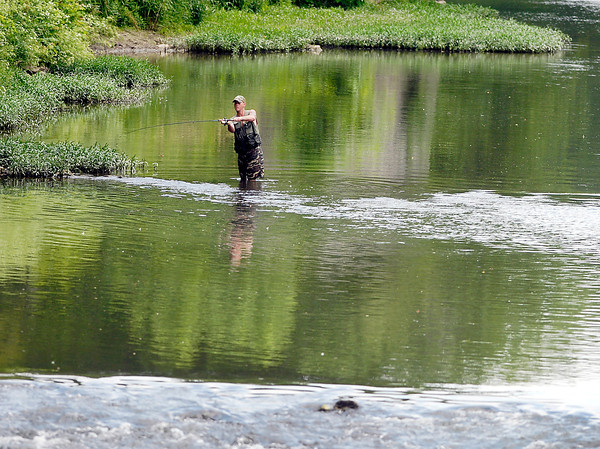 This angler keeps his cast in the calm waters of White River just above the small rapids where the old dam for the power station was near Edgewater Park Tuesday.  With the lack of rain the water level of the river was more conducive to wade in it to go fishing.