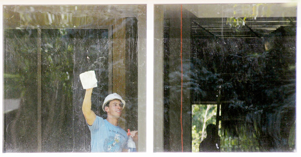 A construction worker cleans a glass wall as construction continues on Anderson University's York Performance Hall and Galleries project on Monday.