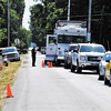 Photo by Abbey<br /> Police set up a command post as they hunt for a suspect in a shooting near Lapel on Saturday