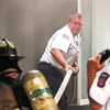 Anderson firefighters battled a smoky house fire at 511 West 5th Street Monday evening.  Here Battalion chief Eric Hutchison pulls fire hose into the front door of the house for the firefighters inside.