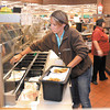 Kaylee Dunham, a Madison County Health Inspector, does an inspection of the Subway shop inside Wal-Mart.
