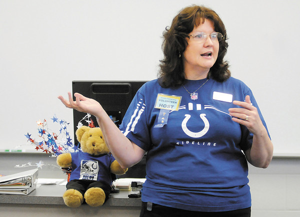 Anderson University's Pauletta Swank leads a training class for new Colts Camp volunteers at Anderson University on Tuesday.