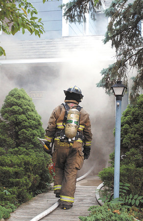 Anderson firefighters battled a smoky house fire at 511 West 5th Street Monday evening.