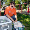 Holly Pollock of New Covenant Ministries prepares to hand out lunches to children at Jackson Park Friday as part of their outreach to provide a sack lunch three times a week to kids over the summer.