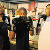 Boxers who represented local gym Basement Boxing & Fitness in Golden Gloves competition. From left, Derrick Glass, Robert Glaze and Josh Logan.