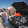 Gene Gann, from Colfax, and Larry Harshbarger, from Frankfort, look over this 1969 Ford Mustang Monday afternoon during the fourth annual Prime Timer Car Show held at Hoosier Park Racing & Casino.