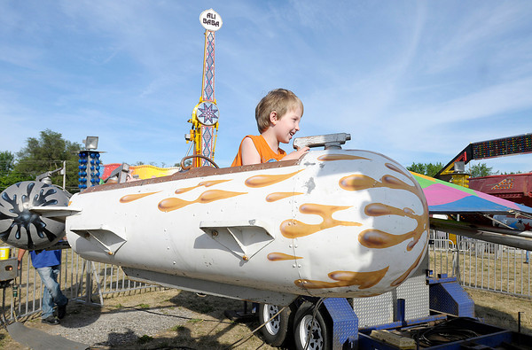 Lucas Peterson, 4, enjoys the rides at the Lions Club Family Festival on opening day at the Anderson Speedway on Wednesday. The festival runs through the 16th.