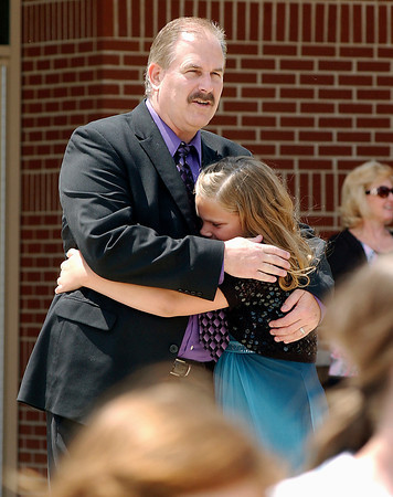 Frankton Elementary School sixth grade teacher Terry Ward says  goodbye to one of his students at the end of the last day of the school year for the Frankton-Lapel school system Wednesday afternoon.