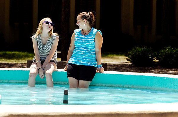 Taylor Kemp, 14, and Casey Patterson, 15, cool off in the Helios fountain at Anderson University Friday afternoon where they were in their last day of a week long Christ In Youth church camp on campus.  Both girls are from Brownsburg, Indiana.