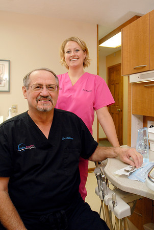 Doctors Michael Robinson and his daughter Molly Weiandt of Father Daughter Dentistry.