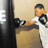 Josh Logan punches a bag at Basement Boxing & Fitness in Anderson on Thursday.