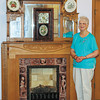 Dorothea Ballard with one of the 5 ornate oak fireplaces original to the late-19th century building which has housed the Ballard & Sons Funeral Home since 1951.