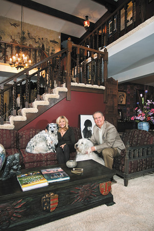Kendall and Judy Zinszer sit with their dogs, Domino and Gracie, in their Forest Hills home that they built in 1974.