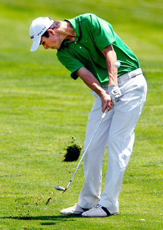 Colin Proctor of Pendleton Heights goes down after the ball on this shot on the 15th hole at Purgatory Golf Club.