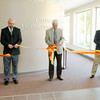 From left, Brad McKinney, Ron Duncan and Merle Strege cut a ribbon opening the Church of God Interpretive Center on Wednesday in time for the Church of God Global Gathering 2013 that kicks off Saturday.