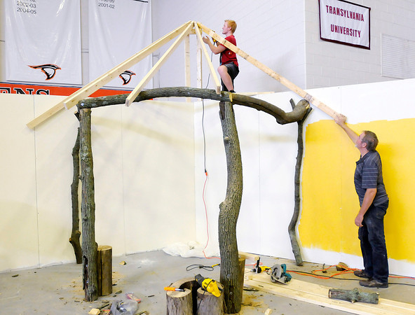 Tim Stevenson holds a board in place as his son Logan secures it with a screw as they work on the Africa display for the Global Expo in O.C. Lewis Gymnasium on Thursday. The Global Expo is part of the Church of God Global Gathering taking place starting Saturday on the campus of Anderson University.