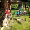 Scott Gull pushes his son Jacob and daughter Makenna on the swing while his eldest Zachary plays with the family dog Bently.<br /> Don Knight/The Herald Bulletin