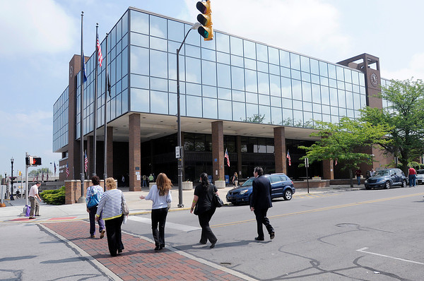 """People re-enter the Government Center after the """"all clear"""" was given following a bomb threat on Tuesday."""