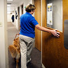 Darra, Joni Breedman's 20-month-old golden retriever seeing eye dog,  escorts Joni around  St. Vincent Anderson Regional Hospital as she goes to a meeting.