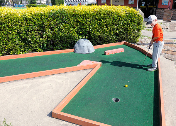 Kaleb Lovell, 9, plays Putt-Putt at Anderson's Putt-Putt Golf and Games on Tuesday. Lovell was spending the day with his grandparents John and Phyllis Lovell.