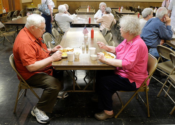 Diana and Jim Coker sit down to a meal of fried fish at the Knights of Columbus in Anderson.