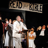"Rev. Jeremiah Brown (Roland VanHorn) conducts a prayer meeting on the eve of the start of the trial  in Mainstage Theatre's production of "" Inherit the Wind."""
