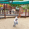 Leonard Dates, 7, plays on the playground at Shadyside park with his brother Abram, 5, on Saturday.