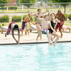 Don Knight/The Herald Bulletin<br /> Kids jump into the Southside Pool as it opened for the summer on Saturday. Pool hours this year are from noon to 5 p.m., Tuesday through Sunday. The entry fee is $3 per person, children 4 and under are free. Children 12 and under must be accompanied by a parent or guardian.