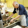 Rick Kilgus fries fish during a fish fry on the first Friday in May at the Knights of Columbus in Anderson.