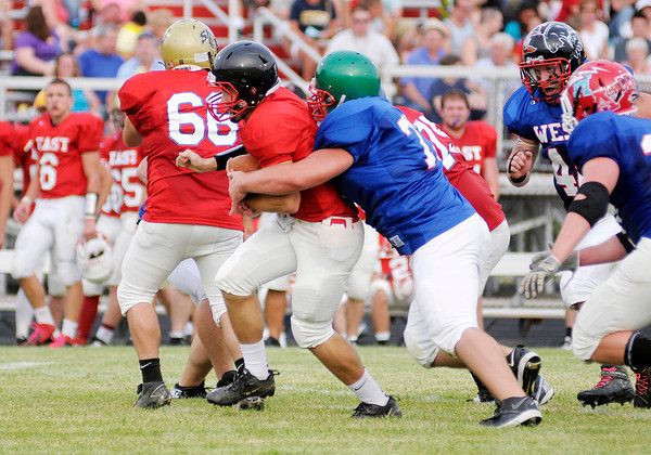 Anderson's Coby Dugger tackles East quarterback Timber Hatfield during the East-West Hall of Fame Classic at Anderson High School on Friday.