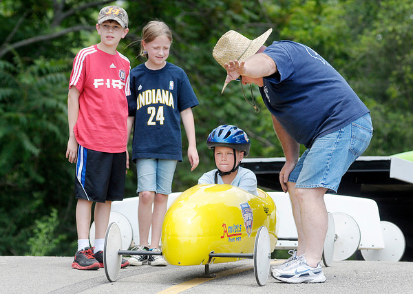 Rick Isom gives instructions to Raymond Ripberger, 10, before he drives down the hill at Derby Downs on Friday. Isom held a practice on Friday to teach new drivers the basics ahead of Saturday's competition.