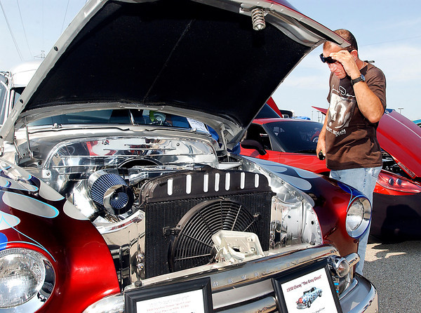 Bob Manderbach of Yorktown raises his sunglasses to get a better look at all the chrome that is under the hood of this 1950 Chevy Deluxe Skyline coup that was on display as part of this years' American Classic Prime Timer Car Show at Hoosier Park Racing & Casino Monday.