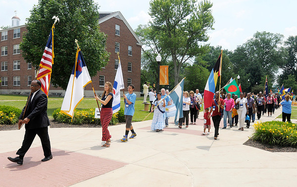 Don Knight/The Herald Bulletin<br /> Delegates from around the world carry their flag as they enter the Kardatzke Wellness Center for the Opening Event of the Church of God Global Gathering  on Saturday.