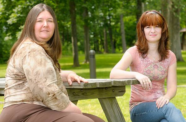 """From left, Kathy Gerstorff and Stacy Savage pose for a picture at Mounds State Park on Friday. The two are collecting submissions for the book """"Naturally Yours: Poems and Short Stories about Indiana State Parks"""""""