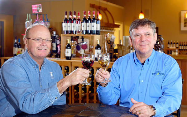 Kevin Tonne and Larry Simmons, of Tonne Winery, 101 W. Royerton Road, Muncie, toast each other.