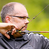Don Knight/The Herald Bulletin<br /> Mike Gossard of Sidney Ohio takes aim during the Regions Archery competition at the Rangeline Nature Preserve on Saturday.