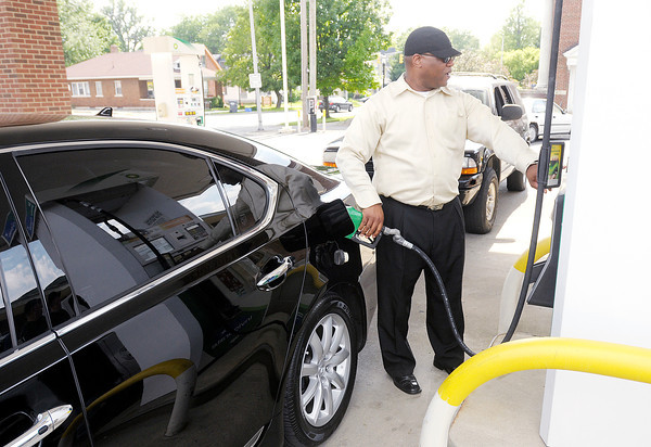 Clinton Hunter of Anderson fills up at the Ricker's on 8th Street in Anderson on Wednesday. Gas prices are expected to be lower this summer.