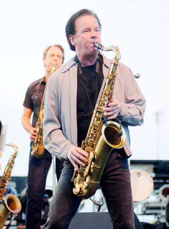 """Don Knight/The Herald Bulletin<br /> Johnny Colla plays saxophone as Huey Lewis and the News open their set with """"Heart of Rock and Roll"""" as the Hoosier Park Racing and Casino Summer concert series kicked off on Saturday. The B-52s & The Go-Go's are up next in the series performing on June 29th."""