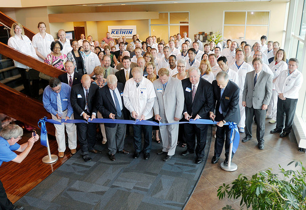Keihin North America held a dedication and ribbon cutting at their new location at the Flagship Enterprise Center in Anderson on Friday. Cutting the ribbon from left are Joy Royer, Greg Winkler, Mayor Kevin Smith, Greg Young, David Eicks, James Edwards and Chuck Staley.<br /> Don Knight/The Herald Bulletin