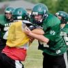 Pendleton Heights High School athletes go through football drills Tuesday.